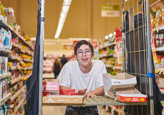 Smiling young man working in supermarket